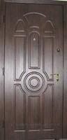 Двери металлические с отделкой.